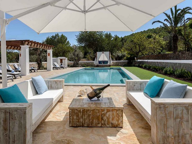 seating area by villa pool