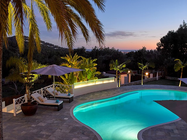 villa with pool in ibiza at night time